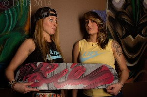 girls holding skateboard
