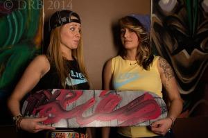 girls holding skateboard